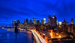 Rush Hour at Blue Hour (DPGold Photos) Tags: nyc travel bridge blue light ny newyork building skyline river downtown cityscape manhattan brooklynbridge manhattanbridge eastriver lighttrails bluehour streaks fdrdrive dpgoldphotos