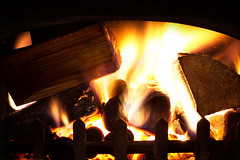 warm me when I'm cold (sneakyrabbits) Tags: life wood uk light orange wales fire still nikon warm flames logs burning burn heat gb ember coal dslr sparks heating warming fuel alight kindle anthracite