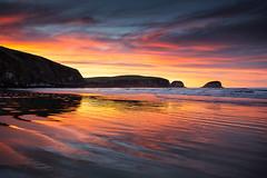 Catlins fire (Luke Tscharke) Tags: morning light newzealand sky reflection sunrise geotagged fire golden glow nz southisland catlins peninsula tautuku geo:lat=46577713263840344 geo:lon=16945557117462158