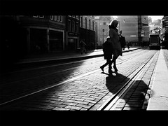 mother and child (Lszl_F) Tags: shadow blackandwhite bw sun monochrome amsterdam silhouette contrast blackwhite fuji shadows tram sunny flare rails fujifilm shadowplay koningsplein fujifilmx10 fujix10
