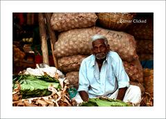 betel leaf seller @Bangalore (samar clicked) Tags: road street portrait india dusty canon bangalore flickraward expressyourselfaward