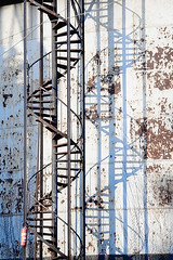 Architecture - Old gas tank (G.P.J.) Tags: old urban brown color building abandoned industry ecology metal stairs danger photo big rust iron industrial tank grunge large rusty nobody gas used pollution oil huge environment weathered heavy