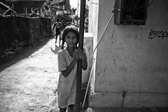 Nemam (Kals Pics) Tags: life light shadow people blackandwhite bw india girl monochrome smile canon happy blackwhite kid candid streetphotography happiness chennai colorless tamilnadu villagepeople cwc villagelife rurallife ruralindia indianvillages 550d nemam thiruvallur tiruvallur ruralpeople kalspics 18135mmis chennaiweelendclickers