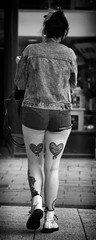 Doesn't wear it on her sleeve (Just Ard) Tags: woman tattoo heart lovehearts shorts denim people person face street photography candid unposed black white mono monochrome bw blackandwhite noiretblanc biancoenero schwarzundweis zwartwit blancoynegro  justard nikon d750 85mm