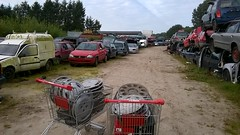 collecting hubcaps (hubcapmate (Germany)) Tags: hubcap scrapyard
