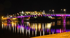 Novi Sad (A. Tadic) Tags: novisad night bridge danube reflection colors dark light dunav donau brucke srbija petrovaradin fortress tvrava serbia exit tourism kej long exposure photo city grad town europe europa water surface rainbow duga black purple lines