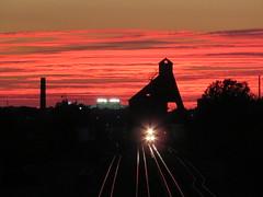 Sunset Tower (tracydekalb) Tags: dekalb huskie huskiestadium niu coaltower sunset train night