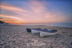 Three Little Boats - Durley Chine Beach. (Emily_Endean_Photography) Tags: lee filters bigstopper bournemouth durleychine beach longexposure sand coast seascape sea seaside dorset boats sunrise clouds cloudporn pink sun autumn september morningdawn dawn morning nikon wideangle