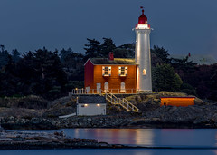 Fisgard Lighthouse (Paul Rioux) Tags: parks canada britishcolumbia bc vancouverisland victoria colwood westshore fortroddhill fisgard lighthouse westcoast old building architecture outdoor seascape seashore seaside waterfront calm reflection lights illuminated led bluehour beach