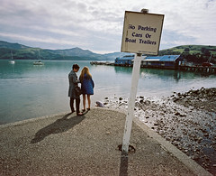 No Parking Cars or Boat Trailers (@fotodudenz) Tags: mamiya7 film rangefinder super wide angle 43mm kodak portra akaroa canterbury banks peninsula medium format christchurch harbour street photography sign no parking boat trailers cars carpark tourists skinny legs 2016