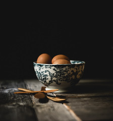 Crates dark and moody #1 (jm atkinson) Tags: purple eggs antique bowl porcelan still moody dark wooden spoons