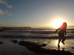 Amy... (Owen H R) Tags: sea sky sun seaweed beach silhouette fun scotland orkney waves play amy action running birsay owenhr