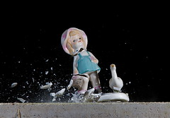 Smash Girl with Goose (Bucky O'Hare) Tags: motion art speed photography high smash break artistic drop ornament stop figure figurine destroy