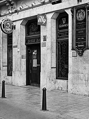 Saint Martin - Irish Bar - Valencia (Fuji XE1) (BW) (markdbaynham) Tags: camera city urban bw irish white black valencia saint bar spain fuji martin drink x system espana spanish local trans guiness compact sensor ccs xe1
