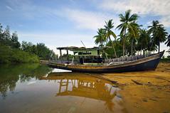 ::Wooden Boat:: (Zawawi Isa) Tags: blue green nature boat wooden fisherman village natural getty kampung kayu sampan gettyimage nelayan perkampungan nikond90 nikonflickraward