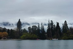 Mist over The Remarkables,Queenstown,New Zealand (scinta1) Tags: queenstown newzealand southisland lake wakatipu remarkables snow mountains cloud mist water blue still trees green boat cloudy dark