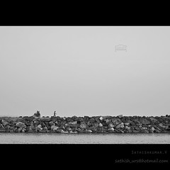 Committed - Single (Sathish_Photography) Tags: bridge sea india white motion black guy travelling beach bike rock composite port walking photography photo fishing couple rocks alone walk madras young area photowalk chennai tamilnadu sathish mim kasimedu