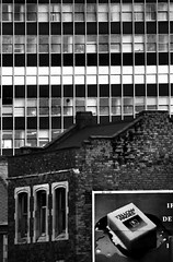 Birmingham, UK (Pictures from the Ghost Garden) Tags: urban blackandwhite bw film monochrome architecture 35mm buildings lens landscape blackwhite birmingham sigma olympus telephoto hp5 analogue ilford om2 westmidlands urbanlandscape midlands blancetnoir