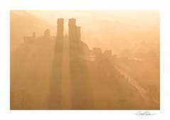 Corfe Castle Sunrise (George-Edwards) Tags: morning england sunlight mist silhouette sunrise landscape dawn golden ruins shadows dorset nationaltrust westhill purbeck sunbeams daybreak raysoflight firstlight corfecastle
