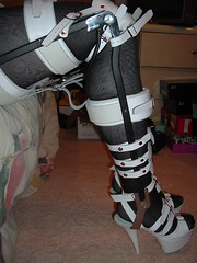 White KAFO's with Triple Ankle Straps, Braces Unlocked But Legs are Still Restrained (KAFOmaker) Tags: sexy leather fetish highheel braces lock bondage heels cuff straight ankle bound buckle locked brace straps cuffs locking confined immobile bracing restraint orthopedics restrain orthopedic cuffed strapped buckling strapping