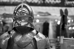 87/133 Brave, Brave Sir Robin, Did Bravely Stand in Spitalfields (Cris Ward) Tags: street old uk blackandwhite bw london monochrome metal shopping walking 50mm prime costume shiny iron shine market britain antique steel sony guard grain stall battle monotone medieval suit knights armor knight shield 365 alpha dslr noise amateur protection armour spitalfields polished beginner dealer greyscale project365 a450 project36587 50mmdtsam
