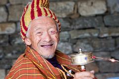 Happiness, the Bhutanese way! (Hulivili) Tags: old man temple happy bhutan buddhist pray praying happiness buddhism national gross thimphu