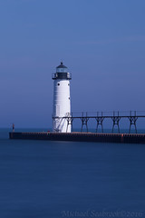 Tranquility (Shadows in Reflection) Tags: longexposure lighthouse fisherman michigan manistee northpierhead