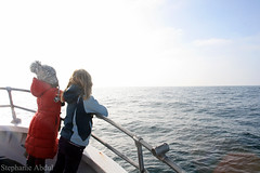 Two Girls Look onto the Open Sea (cleverfoxphotography) Tags: ocean california morning girls sea two water hat port children bay boat monterey warm sailing ship looking pacific dolphin coat watching bow sail whale distance parka