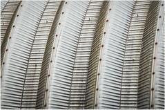 Matt_Langton0601 (matt_langton70) Tags: nikond90 lightroom colorefex4 buxton derbyshire silver metalwork metal rivets curve ribbed steel rust industrial building architecture arch abstract
