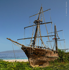 OLD PIRATES SHIP (GREECE, AEGEAN SEA) (KAROLOS TRIVIZAS) Tags: sea plants beach boat sand sailing ship pirates pebbles greece corsair mast ropes spar tackle rigging rigs sailingboat aegeansea digitalcameraclub blinkagain bestofblinkwinners