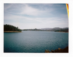 South Holston Dam (Brock5604) Tags: trees winter sky lake mountains film water clouds bristol polaroid march spring rocks fuji outdoor dam tennessee shore instant tva southfork southholston