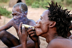 Bushmen (San) tribe, Tsumkwe, Namibia (Igor Bilic) Tags: africa people men dreadlocks southafrica photography bush san village desert african smoke traditional pipe culture documentary tribal smoking remote botswana dope tribe ethnic hairstyle namibia kalahari indigenous hunters namib bushmen southwestafrica thegodsmustbecrazy okawango tsumkwe omaheke gobabis igorbilic thelifeofmammals