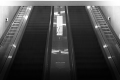 Stairway of Symmetry (Justin Kauffman | Kauffman Kreative) Tags: seattle travel las vegas blackandwhite motion art canon photography airport escalator symetry lglass t2i