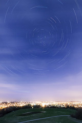 20130425_F0001: Yet another cloudy city star trail (wfxue) Tags: road street city longexposure light sky house night clouds dark circle stars star movement trail astronomy startrails