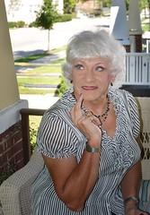 Sometimes I Wonder . . . (Laurette Victoria) Tags: woman blouse silver porch laurette necklace face eyes