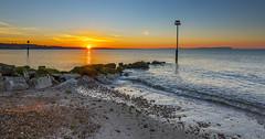 Sunrise Pebbles (nicklucas2) Tags: seascape beach groyne isleofwight needles sea solent pebble wave sun