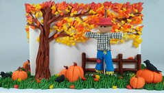 Scarecrow (Edible Delights) Tags: scarecrow halloween pumpkins crow autumn fall yellow red orange cute cake fondant gumpaste tree fence
