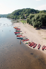 Riverside (m-blacks) Tags: dordogne france perigord canoes limeuil aquitaine limousin villagesdefrance vzre river boat colorful fujifilm fujifilmx30 water riverside canoeing