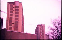 Regent Park towers (Beaulawrence) Tags: film grain analog lomo lomographpy sooc toy camera cheap jcbm fa 868 plastic fantastic lens wierd tungstan t64 slide cross processed xpro color shift colour negative december 2012 dec winter toronto ontario canada to on ont tower projects social housing regent park residential apartment building