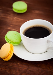 Cup of coffee with macarons (BoyarkinaMarina) Tags: party food france cup coffee cake closeup dessert cookie tea chocolate decoration stack gourmet biscuit macaroon snack heat pastry espresso multicolored heap luxury meringue variation traditionalculture refreshment fragility sweetfood frenchculture