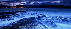 Blue sea landscape at night (Iigo Escalante) Tags: blue sunset sea sky espaa costa sun black sol water vertical azul stone clouds landscape atardecer coast mar spain agua rocks waves negro silk paisaje national shore cielo nubes reflejo planet conde lonely fotografia seashore olas bizkaia seda vasco euskadi geographic vizcaya rocas pais norte nast piedras traveler cantabrico cantabric iigoescalante