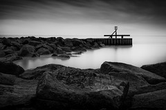 Calm before the storm (Steven Docwra) Tags: longexposure sky blackandwhite seascape clouds mono suffolk nikon rocks milky breakwater d800 lowestoft nesspoint 10stopfilter