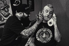 Javi Bermudez (Jolie Rouge) (Jonathan Minto) Tags: portrait blackandwhite bw london art tattoo neck ouch pain brighton punk gun artist sleeve highiso tattooing 2013 iso5000 brightontattooconvention canon5dmkii jolierouge canon50mmef18lens jonathanminto javibermudez