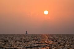 Voggy Maui Sunset (hawaiiansupaman) Tags: ocean sunset sea sun seascape water clouds sailboat canon hawaii haze maui vog hawaiiansupaman