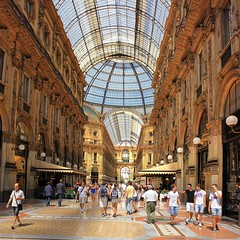 Most popular covered shopping street in Milan (Bn) Tags: street city blue summer sky italy sun holiday money milan hot window weather shop mall shopping walking square cuisine louis topf50 warm italia catholic cathedral roman top milano pigeons centre sightseeing restaurants sunny tourist gucci milaan ii covered shops summertime marble piazza duomo charming exquisite middle too prada topf100 ages galleria romans attractions emanuele vittorio luxurious duomodimilano vutton 35c 1386 100faves 50faves atmospheres dommdemilan