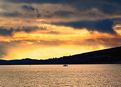 Stormy sunset (Bathsheba 1) Tags: sunset sea clouds landscape boats bay scotland lunderston cowalpeninsula towardpoint firthoftheclyde canonpowershotsx50hs