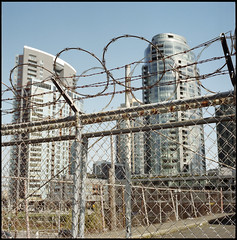 Restrictions (Sebastian B-B) Tags: 6x6 film architecture fence mediumformat portlandoregon razorwire fencedin hasselblad503cx fencedout