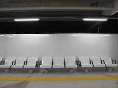 nine white chairs (Samm Bennett) Tags: station japan tokyo chair seat rail shimokitazawa nonplace