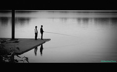 So This is Fishing (Beachhead Photography(Is in standby mode)) Tags: friends bw water sport fishing dock relaxing pole recreation piling fishingpole cmwdblackandwhite artlegacy beachheadphotos