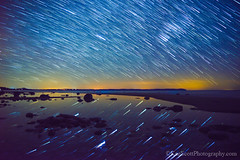 Good Harbor Bay ... starry night (Ken Scott) Tags: longexposure usa night stars march spring michigan lakemichigan greatlakes startrails freshwater voted leelanau pyramidpoint 2013 80photos starstack sbdnl sleepingbeardunenationallakeshore mostbeautifulplaceinamerica
